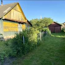 Дом с участком, гаражом, хоз.постройками. 2 веранды, 2 входа, в г.Молодечно