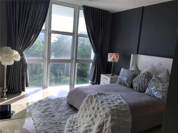 Роскошный двухуровневый апартамент в Авентуре в фото 7